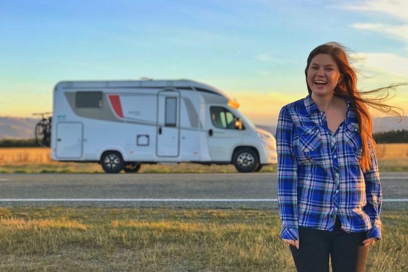 Alyssa posing in front of her Wilderness motorhome