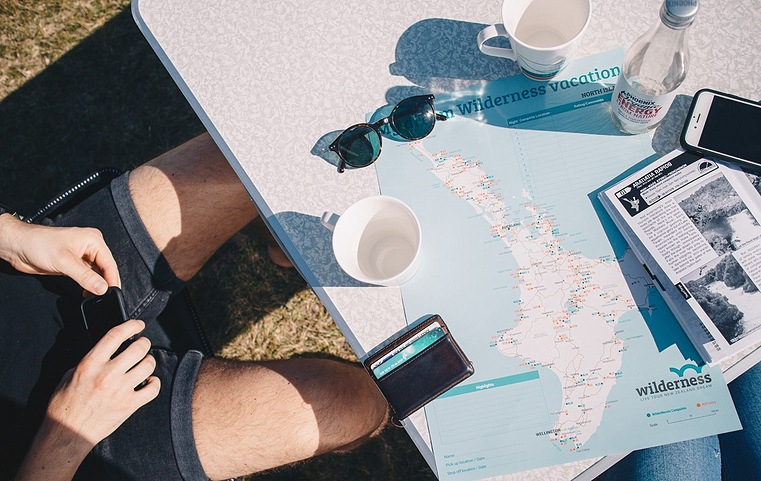 map and sunglasses on a table