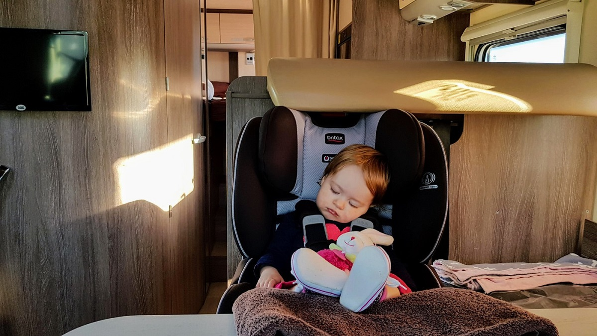 Baby in a car seat in a Wilderness motorhome