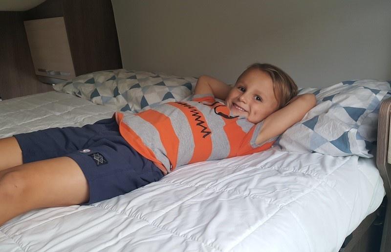 Children relaxing in a motorhome dropdown bed