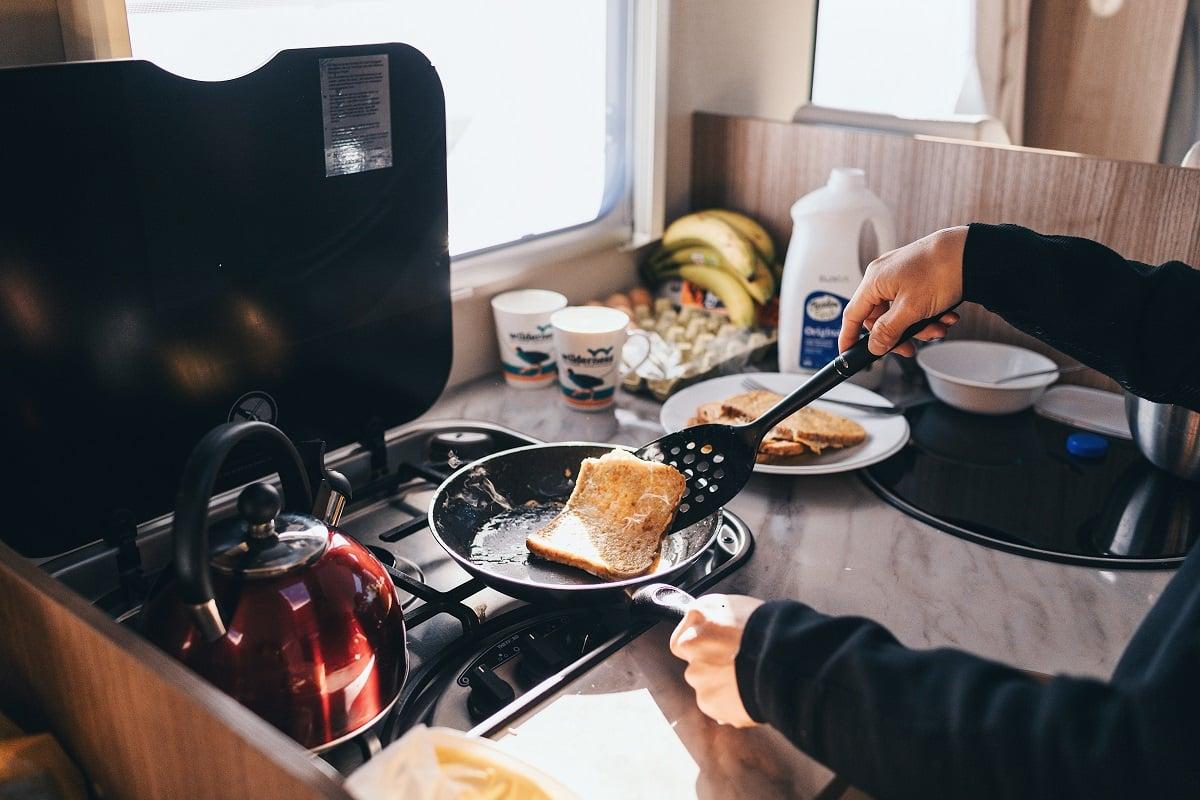 Cooking breakfast in a Wilderness campervan
