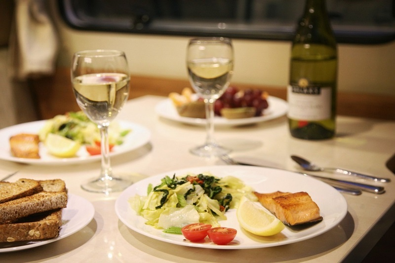Cooking salmon and salad dish in a campervan rental Credit: @summerpluto