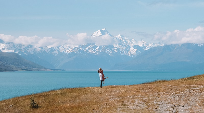 Couple enjoying beautiful views on their NZ campervan holiday
