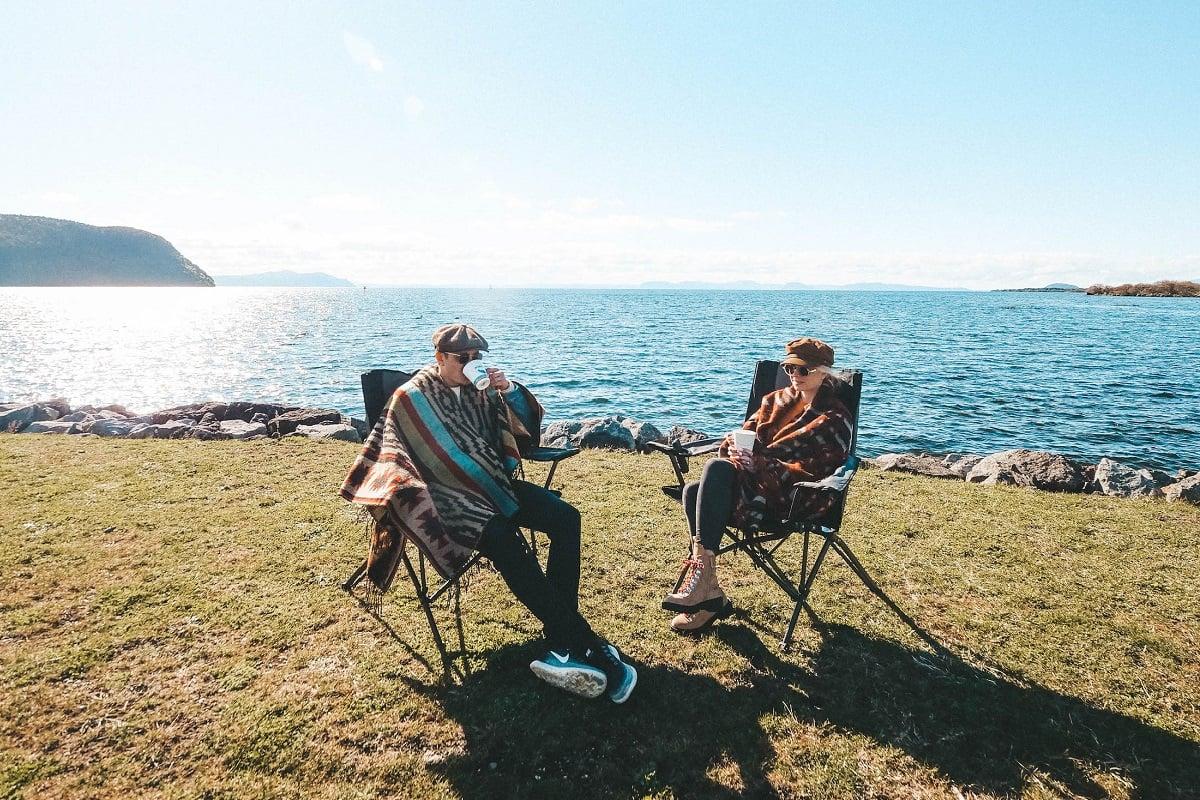 Couple enjoying the sun on their New Zealand motorhome holiday