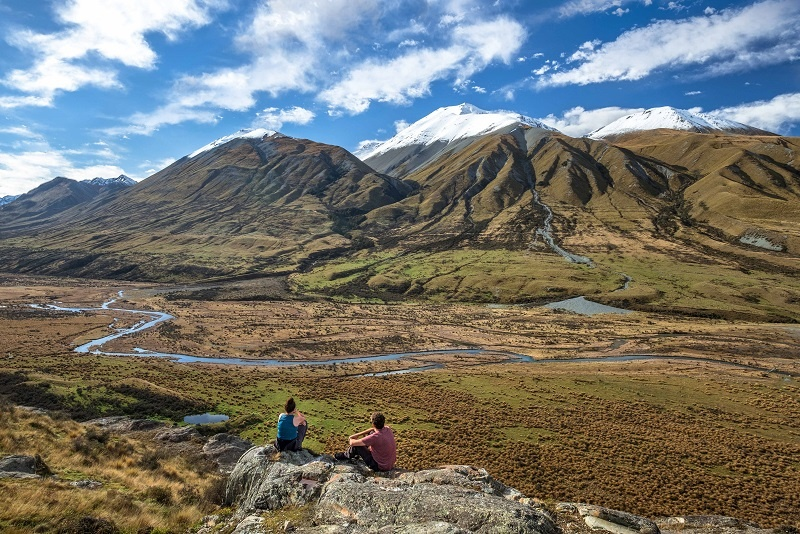 Couple gazing at Mount Sunday New Zealand