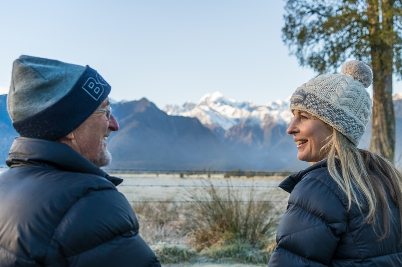 Dad and daughter looking at Lake Matheson