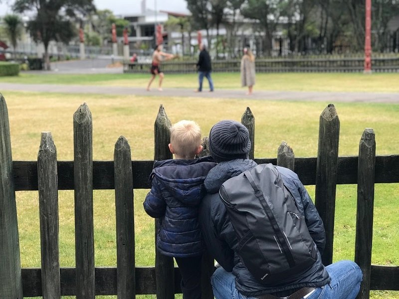Dad and son watching a New Zealand traditional powhiri