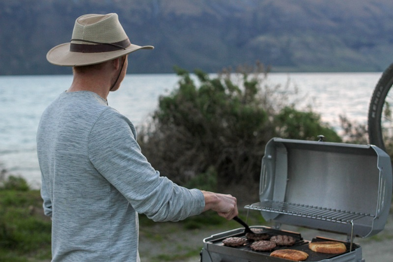 Doing a barbecue while travelling New Zealand in a motorhome rental