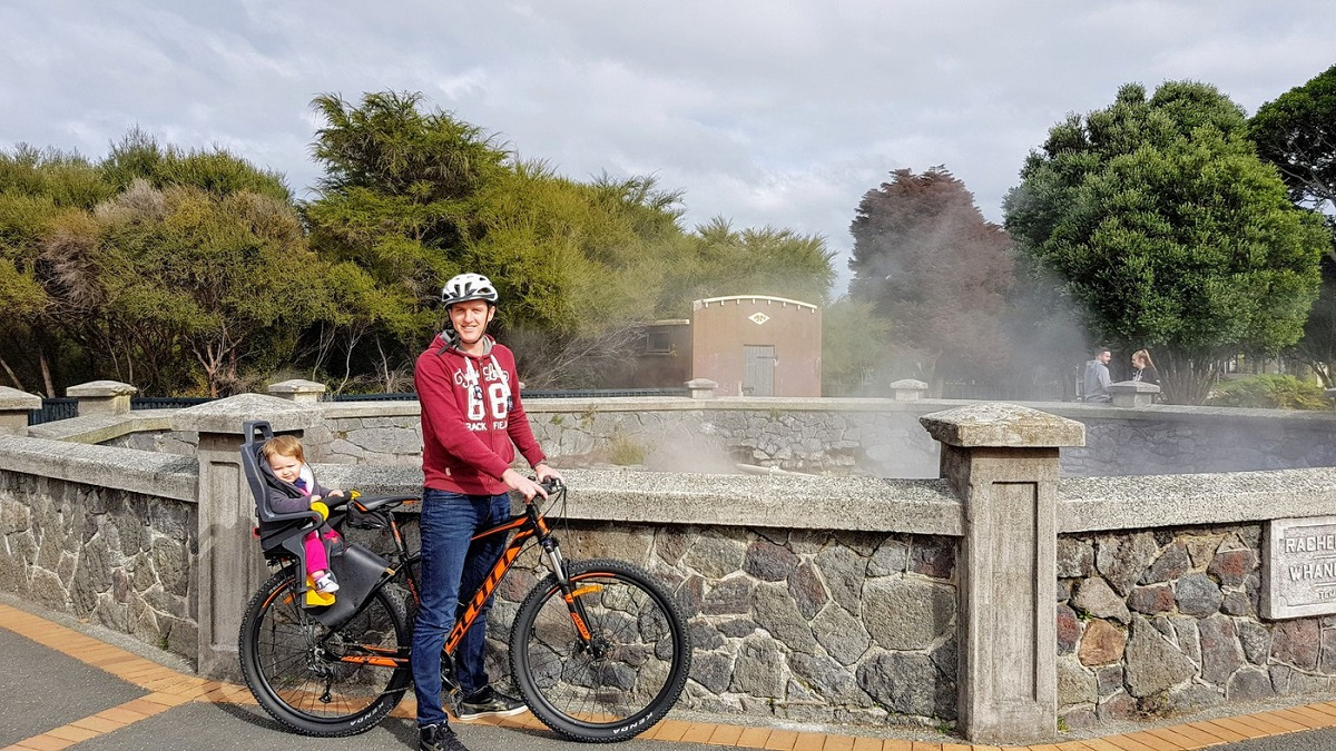 Enjoy a bike ride with your kids while travelling NZ in a campervan