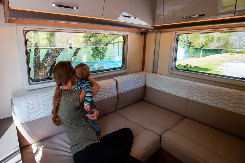Family enjoying the view from their campervan