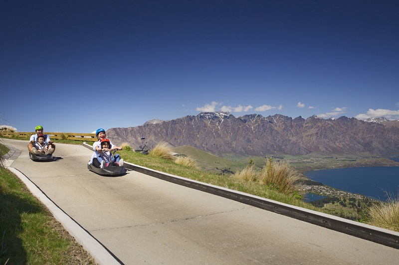 Family lugeing in Queenstown New Zealand