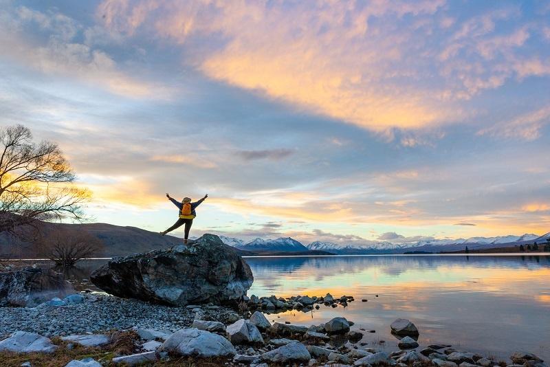 Girl watching at Lake Tekapo New Zealand