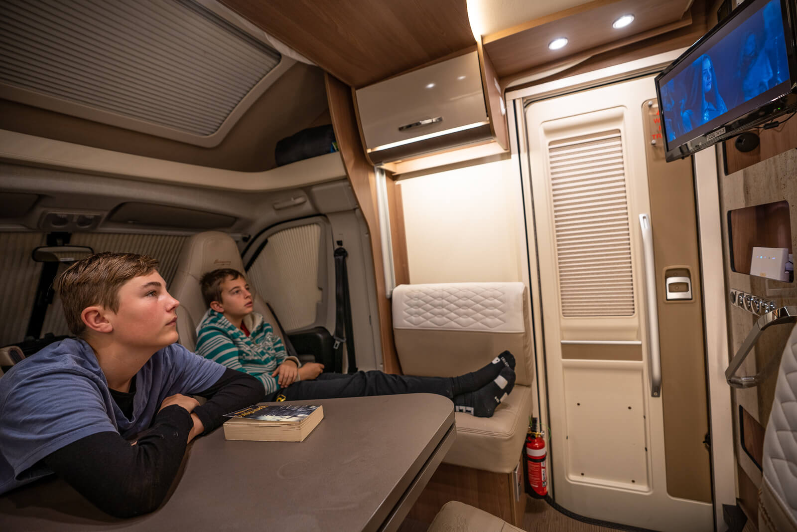 tweens enjoying dvd and onboard wifi of a Wilderness Motorhome