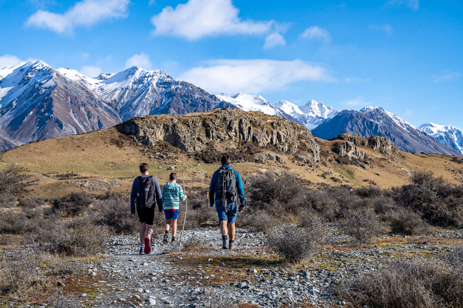 family hiking up Mount Sunday in South Island