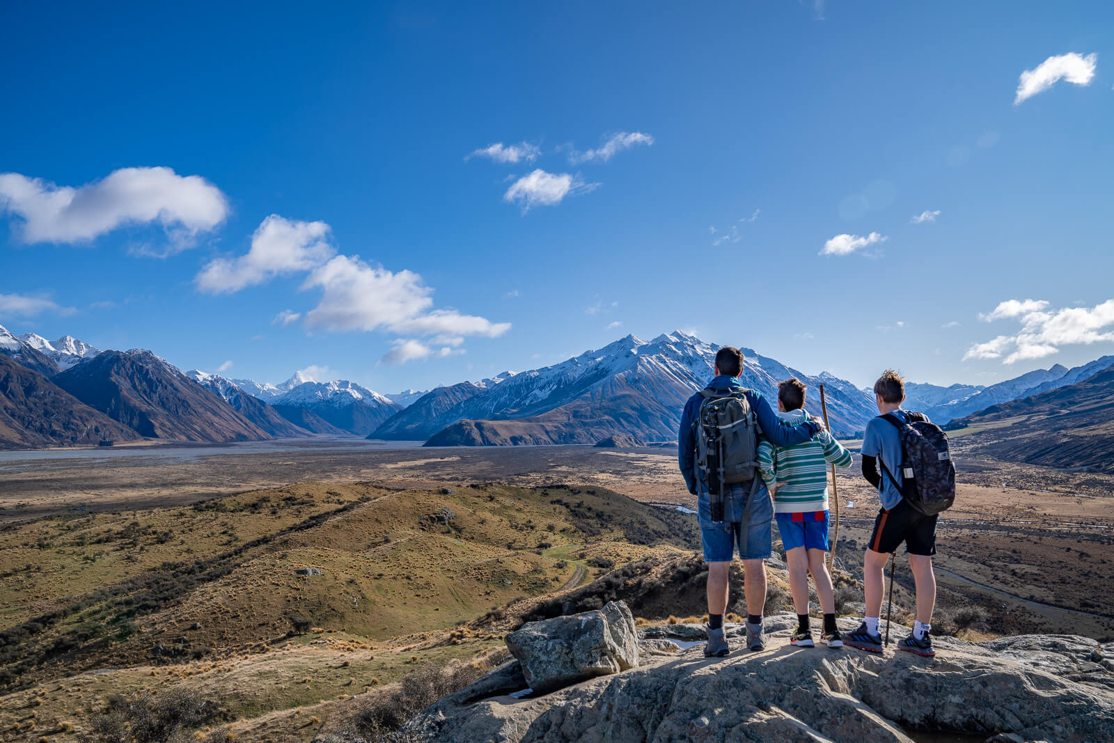 family hiking up Mount Sunday in New Zealand