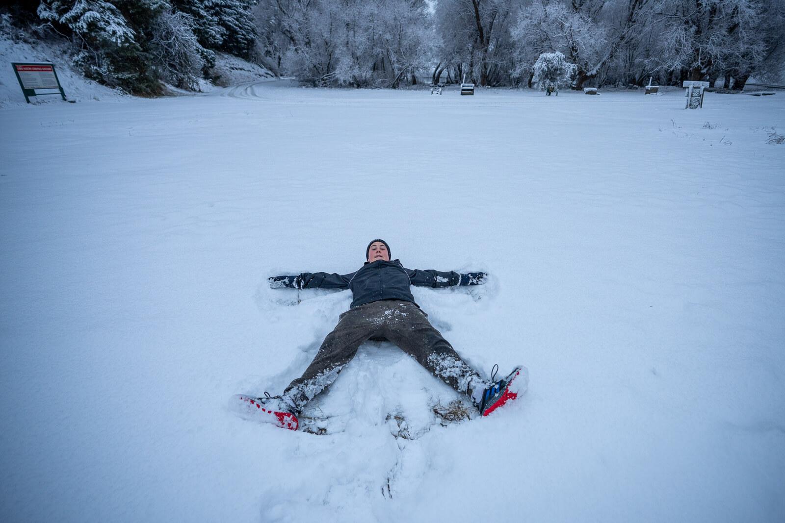 tween enjoying snow at Lake Heron