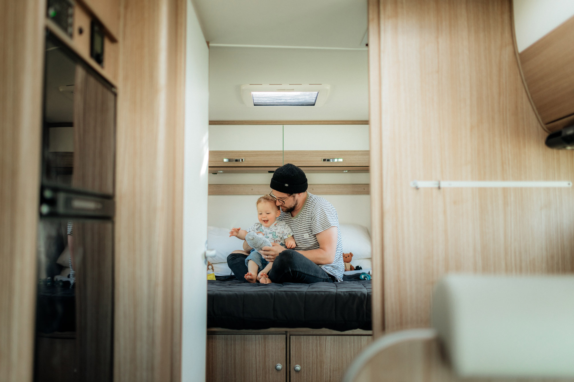 baby and dad on bed in motorhome 2
