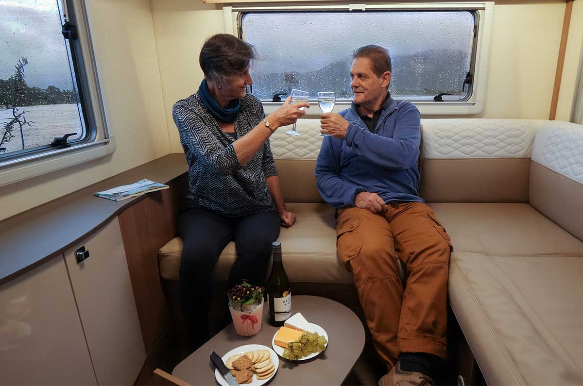 Enjoying-wine-and-cheese-in-the-cosy-Glider-4-motorhome
