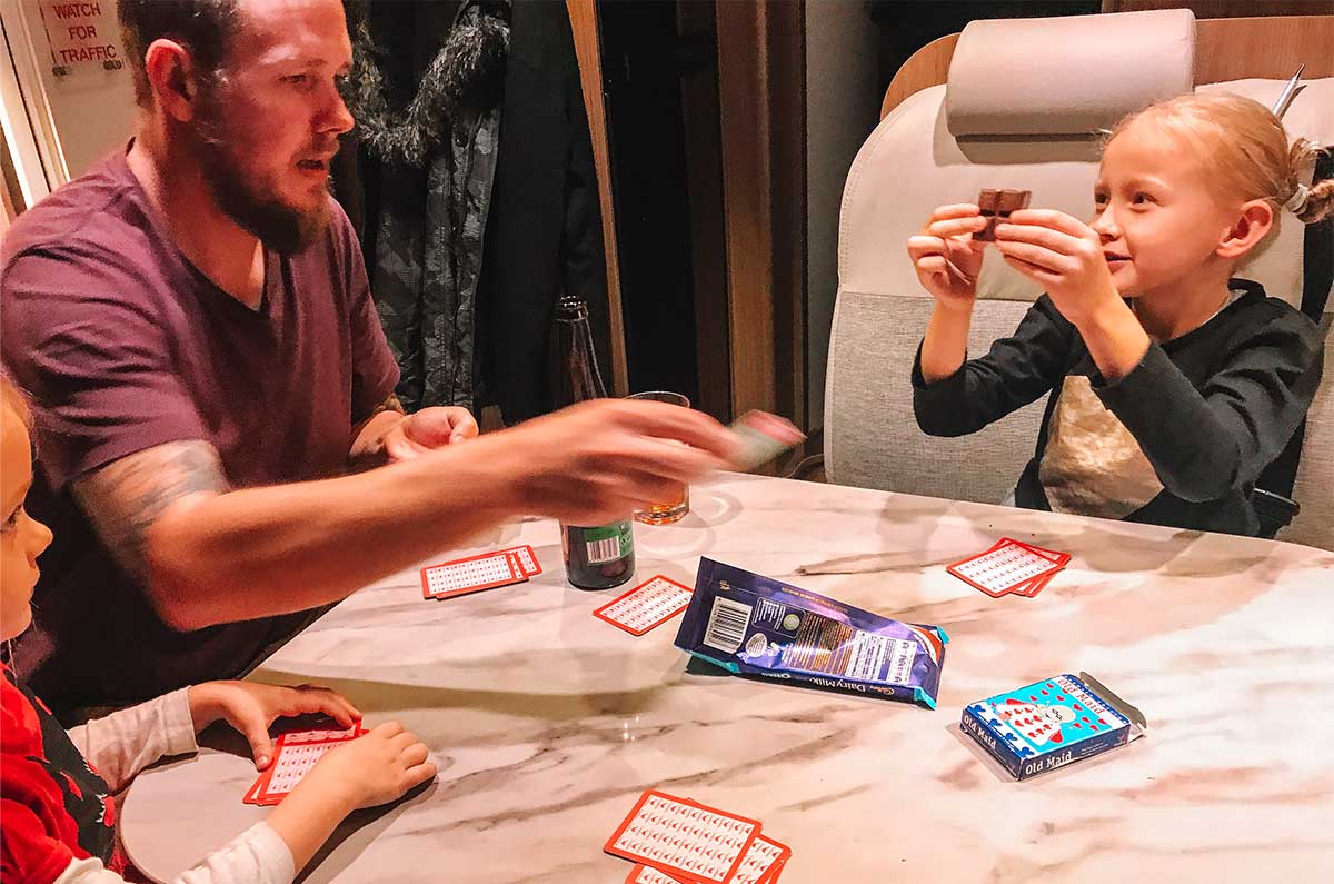 Family-playing-cards-in-a-motorhome