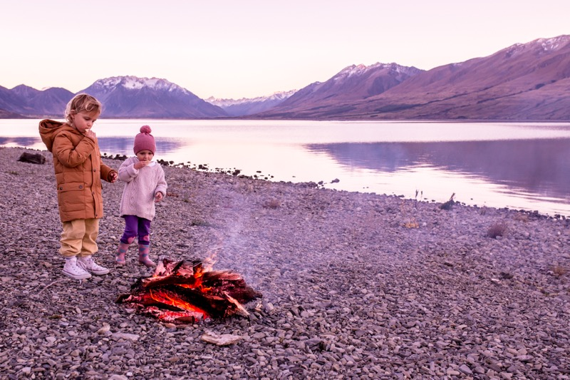 Kids in front of a bonfire in New Zealand