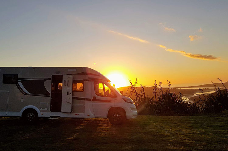 Motorhome-parked-on-a-field-sunset