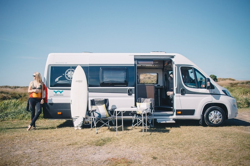 Woman traveling in a Wilderness Compact for 2 campervan