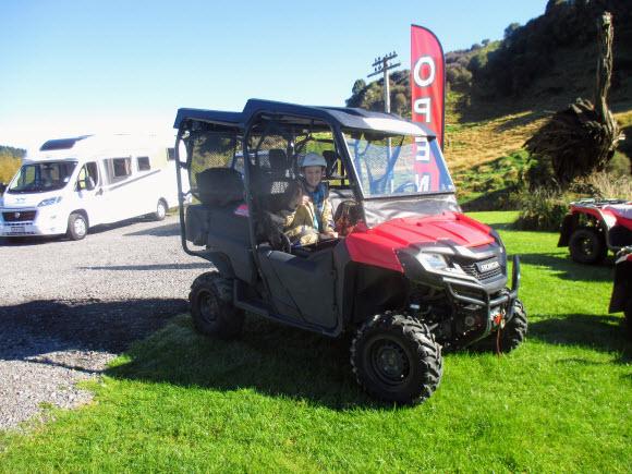 Girl enjoying a 4x4 quad bike ride on her NZ motorhome trip