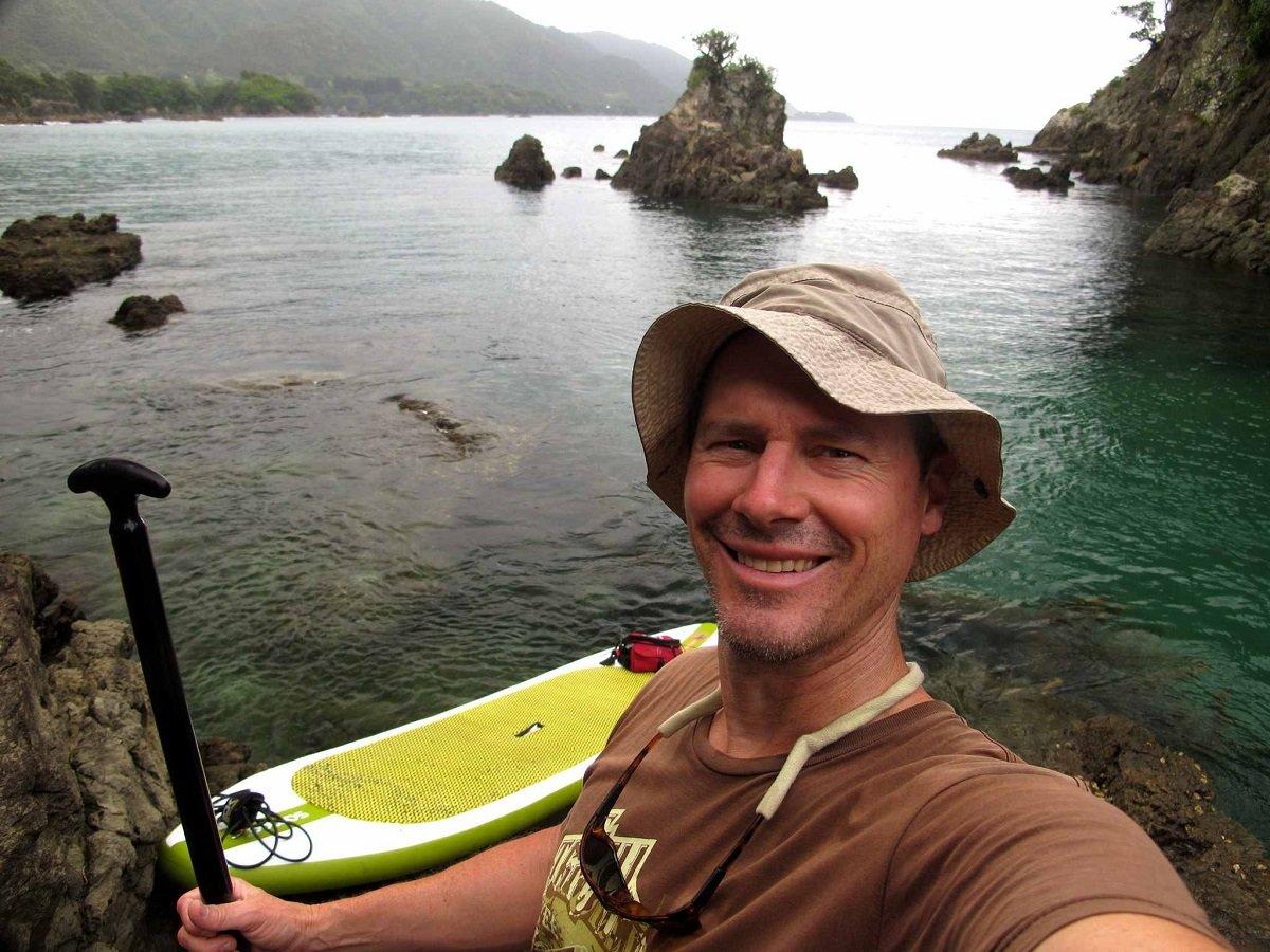 Scott-Cook-exploring-maraehako-on-a-sup-board