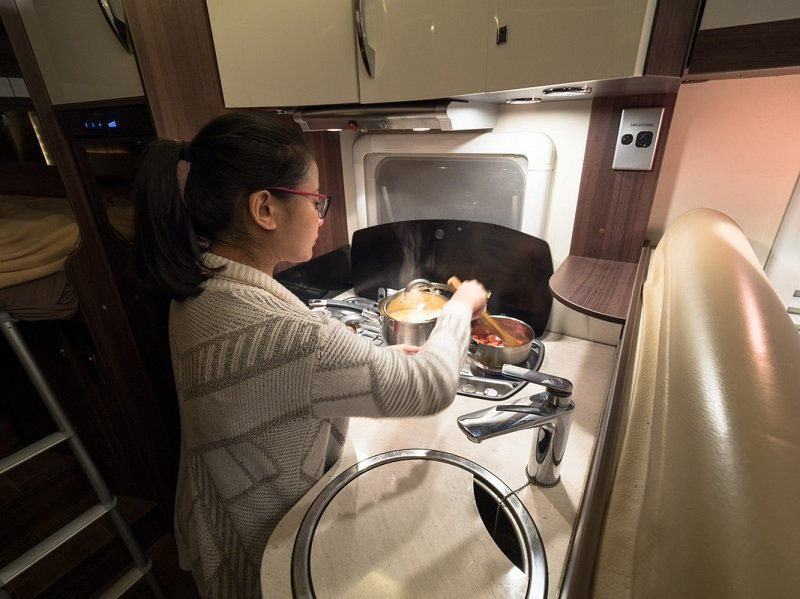 Spacious campervan kitchen for cooking on the road