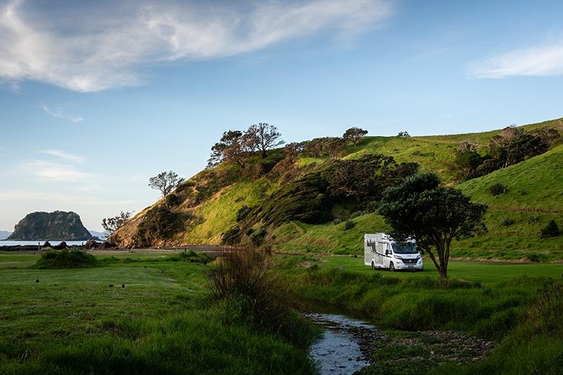 Wilderness Motorhome parked at Fletcher Bay New Zealand