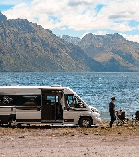 couple with their motorhome on the beach