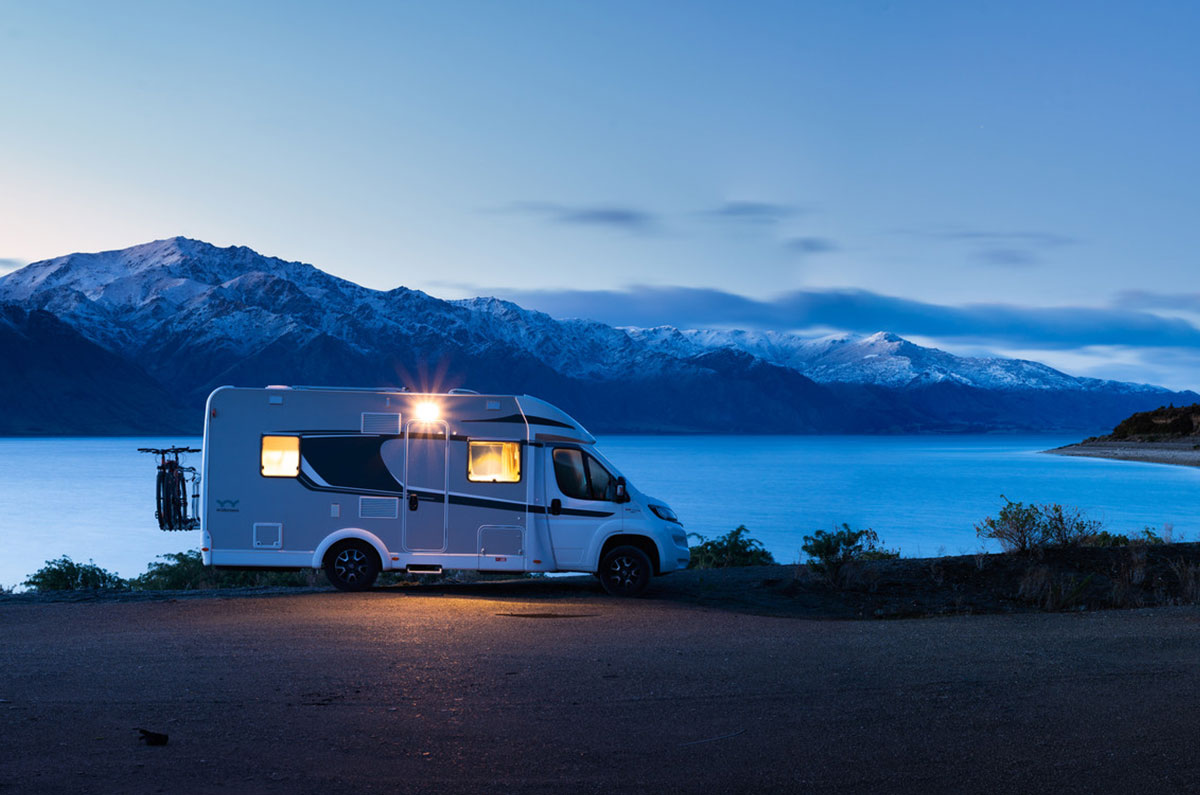 Warm-motorhome-with-snow-capped-mountains