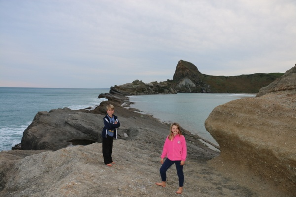 Kids exploring Castlepoint Lagoon in North Island NZ