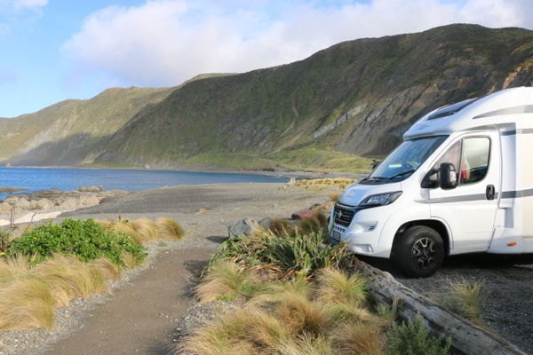 Wilderness motorhome parked along Owhiro Bay, Wellington