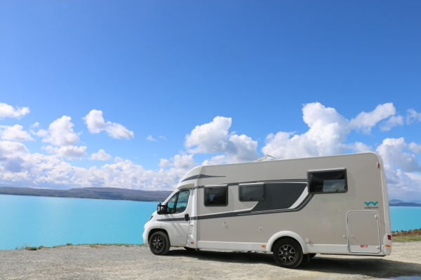 Wilderness Motorhome parked by the blue Lake Pukaki, South Island