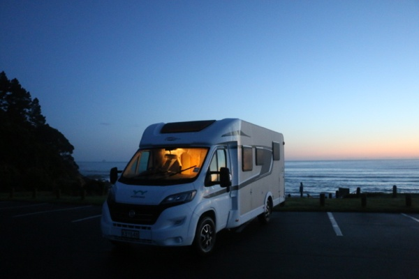 Outlander 4 motorhome parked next to the ocean