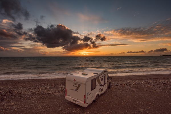 Wilderness camper parked on the Coromandel Coast during sunset Brent Purcell